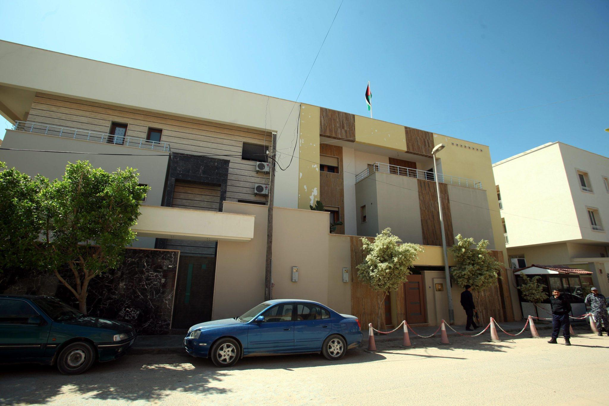Libyan security officers stand in front of the Jordanian Embassy in Tripoli, Libya, after Ambassador Fawaz Itan was kidnapped by masked gunmen.