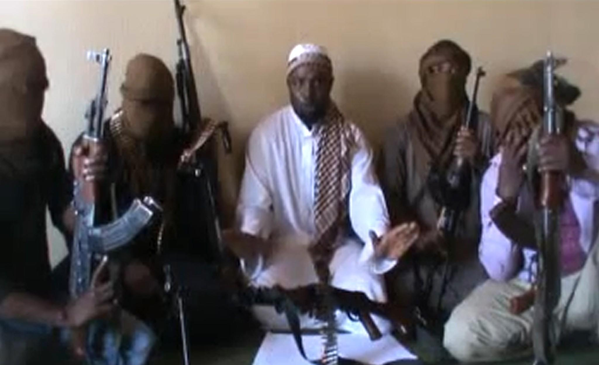 Residents of Chibok, Nigeria, say the militant group Boko Haram abducted dozens of schoolgirls from their boarding school in the middle of the night. Above, a screen capture of a video posted on YouTube in April 2012 that purports to show members of Boko Haram.