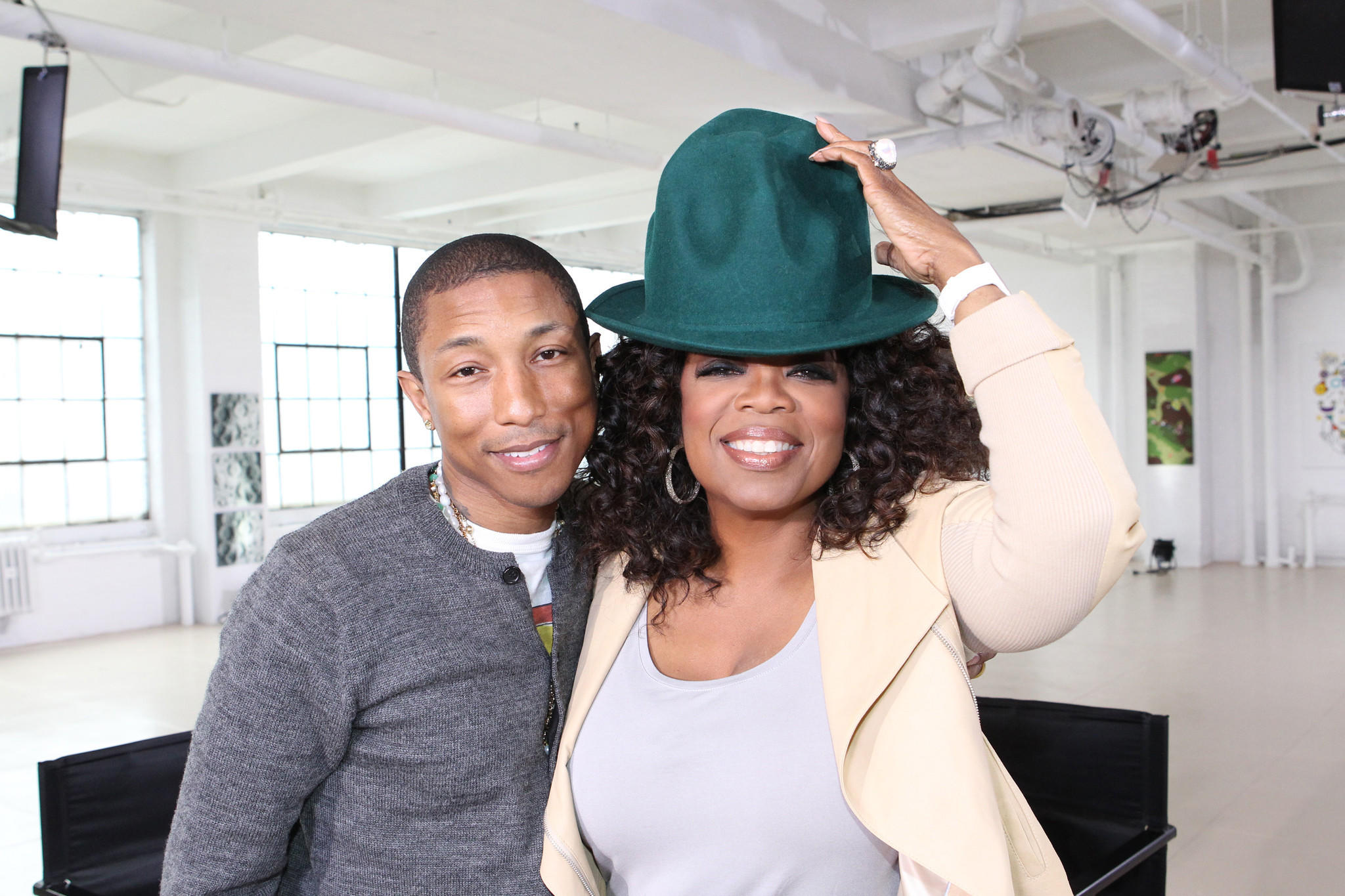 "Singer Pharrell Williams cries on ""Oprah Prime"" following a fan tribute video for his hit song ""Happy."""