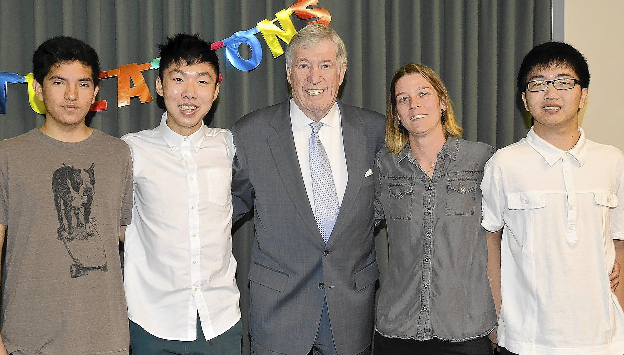 Benefactor Ray Adams, center, with recipients Sergio Anleu, from left, Kevin Zhang, Candace Fournier and Yun Chang during last week's scholarship presentation.