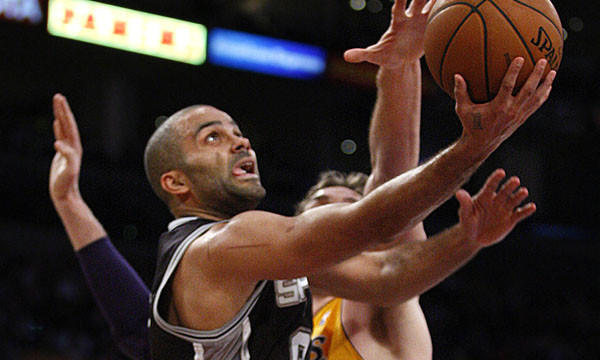 San Antonio Spurs point guard Tony Parker puts up a shot in front of Lakers center Pau Gasol during the Lakers' loss on March 19.