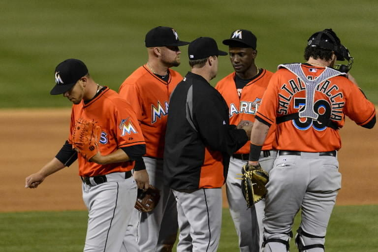 Miami Marlins pitcher Jose Fernandez (16) leaves the mound after being relieved by manager Mike Redmond during the fifth inning against the Philadelphia Phillies at Citizens Bank Park.