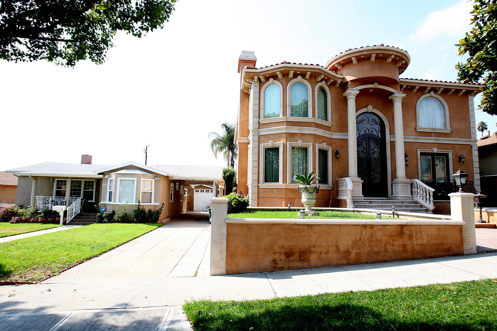 "A home in Burbank that is considered ""mansionized"" dwarfs the residence on the left on Monday, August 26, 2013. Burbank historical officials will discuss guidelines in dealing with mansionization."