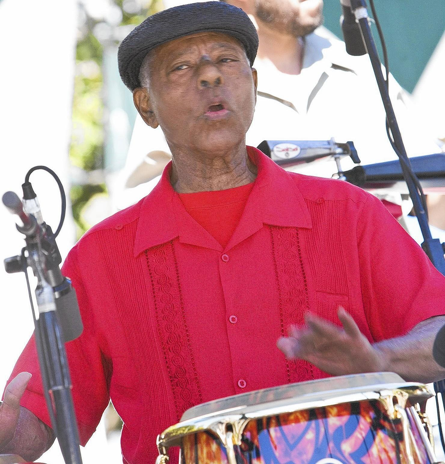 "Armando Peraza performs at Yerba Buena Gardens in San Francisco in 2007. ""When he played, he would move his hands in a dramatic fashion in dance-like moves,"" said John Santos, a San Francisco bandleader."