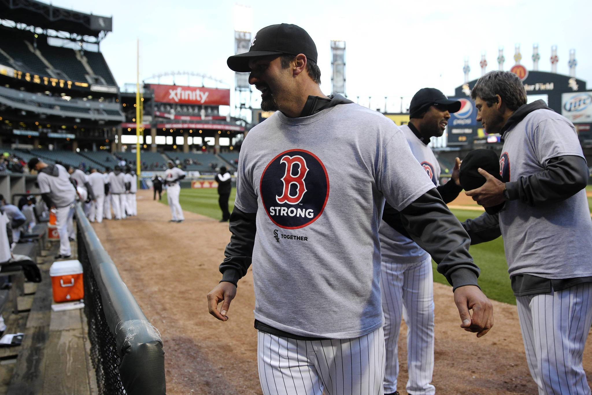 """White Sox first baseman Paul Konerko wears a """"Boston Strong"""" T-shirt along with his teammates before a game against the Red Sox on Tuesday at U.S. Cellular Field."""