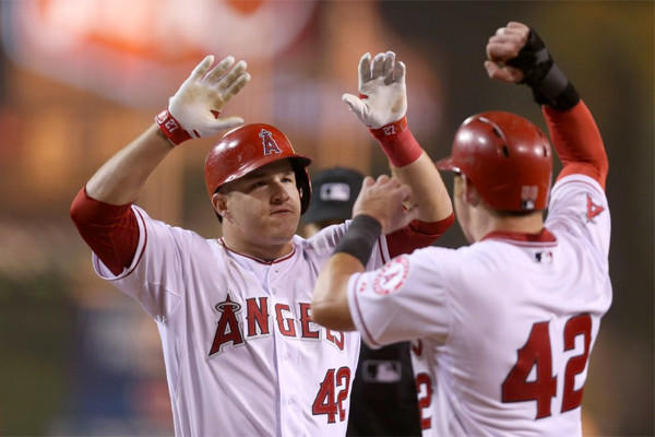 Mike Trout celebrates after hitting a two-run game-tying blast in the bottom of the ninth inning Tuesday to force extra innings with the Oakland Athletics. The Angels lost to the Athletics, 10-9, in 11 innings.