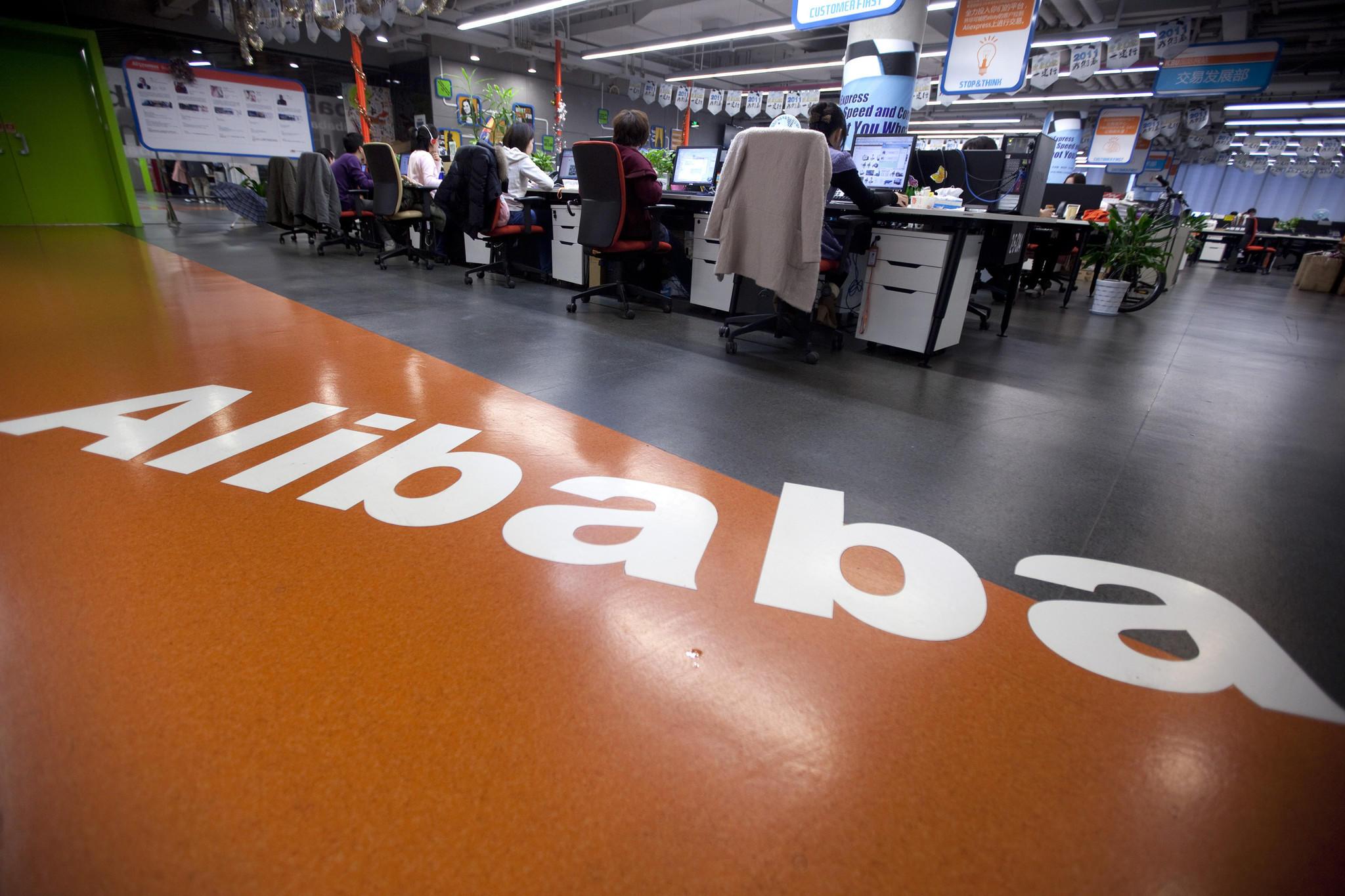 Employees work at Alibaba.com Ltd.'s headquarters in Hangzhou, China.
