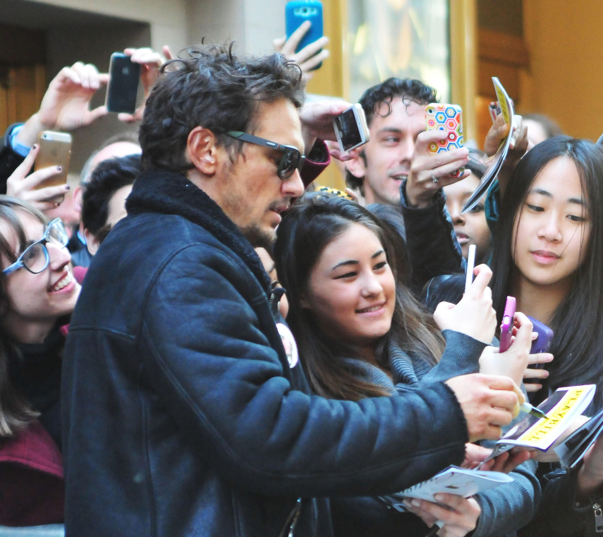 "James Franco, starring in ""Of Mice and Men"" on Broadway, signs autographs for fans."