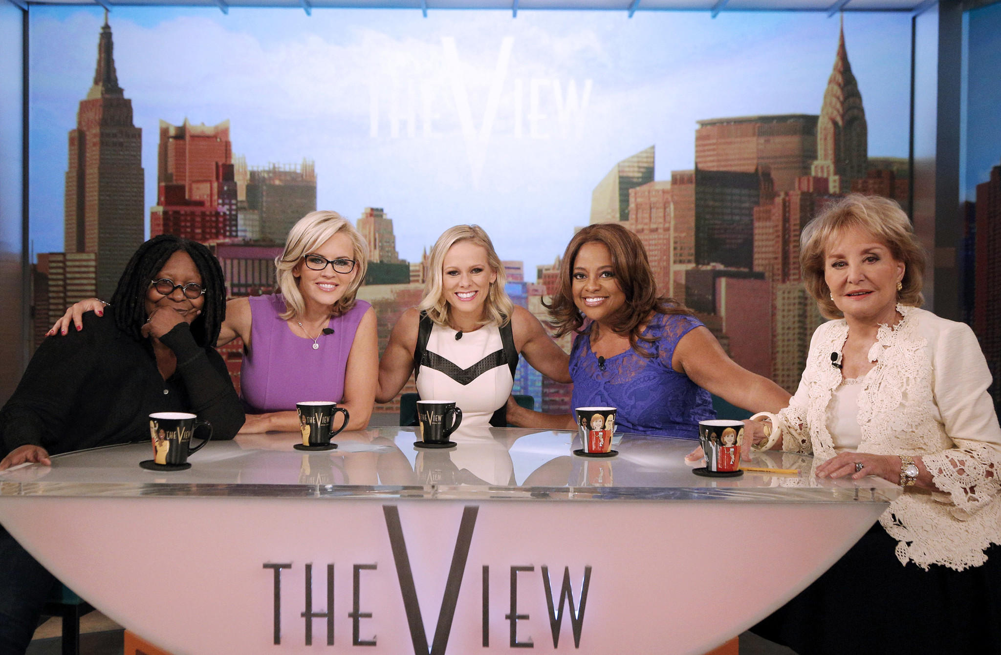 """The View's"" Barbara Walters, right, with Whoopi Goldberg, left, Jenny McCarthy, political commentator/guest Margaret Hoover and Sherri Shepherd. The ABC show will gather all 11 past and present co-hosts to salute the retiring Walters in a first-ever reunion that will air May 15."