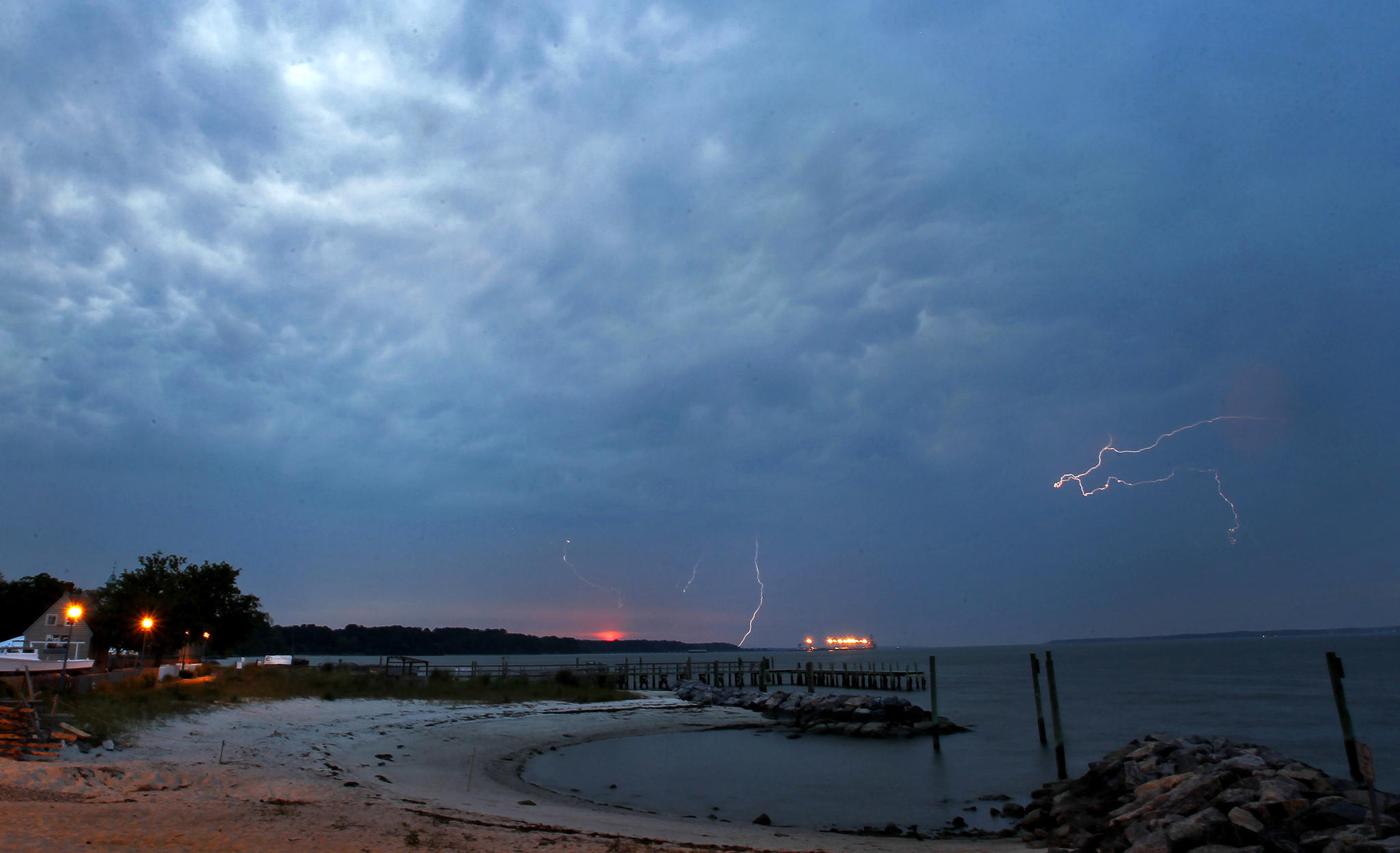 Storm clouds move into Yorktown beach in the evening in June 2013.