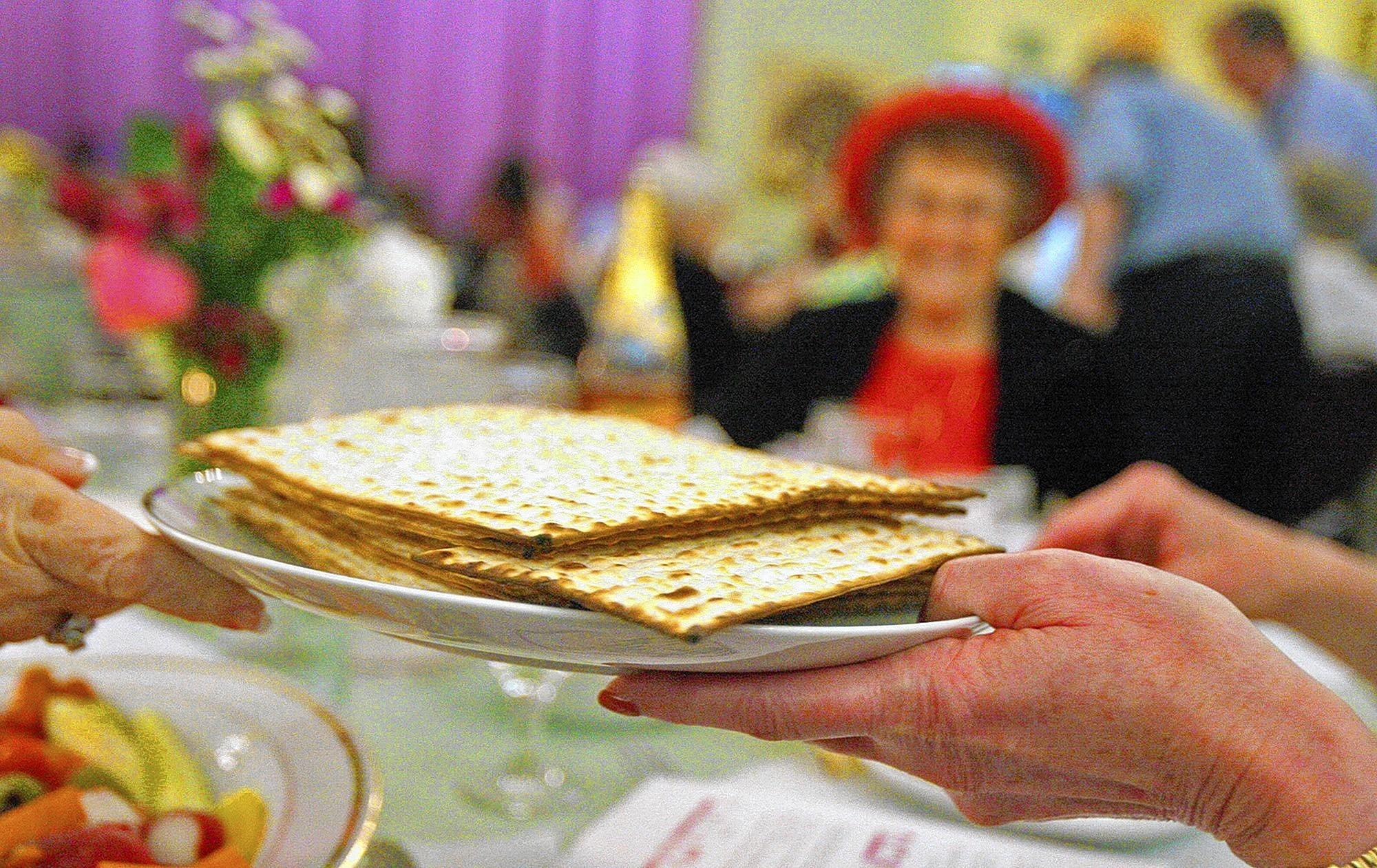 Matzah is passed during Passover Seder at Temple Sinai in Glendale on Tuesday, April 15, 2014. The Seder service marks the beginning of Passover.