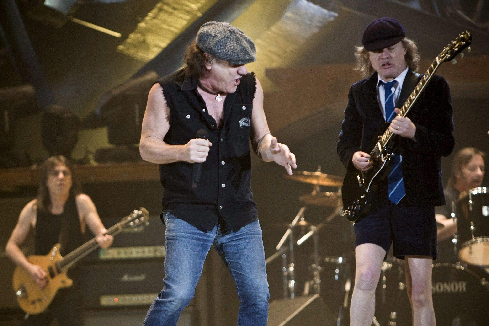 AC/DC lead singer Brian Johnson, center, Scottish guitarist Malcom Young, left, and his brother Angus Young, shown performing in Switzerland in 2009. Johnson has dismissed reports that the group is disbanding because of Malcolm Young's health.