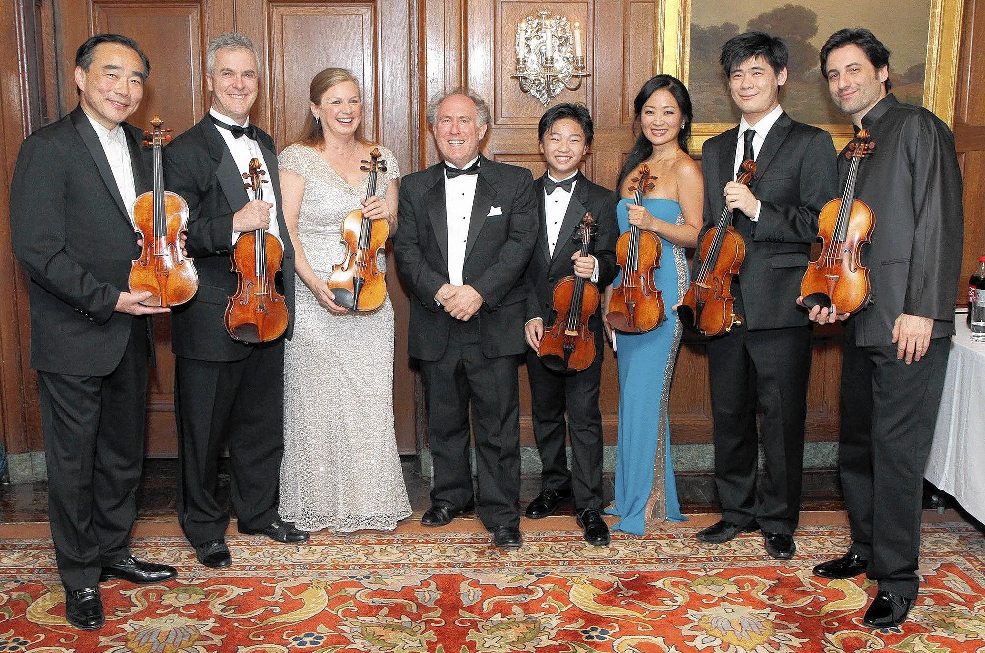 The stars of the night at the L.A. Chamber Orchestra Strad gala are, from left, Cho-Liang Lin, Martin Chalifour, Margaret Batjer, LACO Music Director Jeffrey Kahane, Ray Ushikubo, Chee-Yun, Xiang Yu and Philippe Quint.