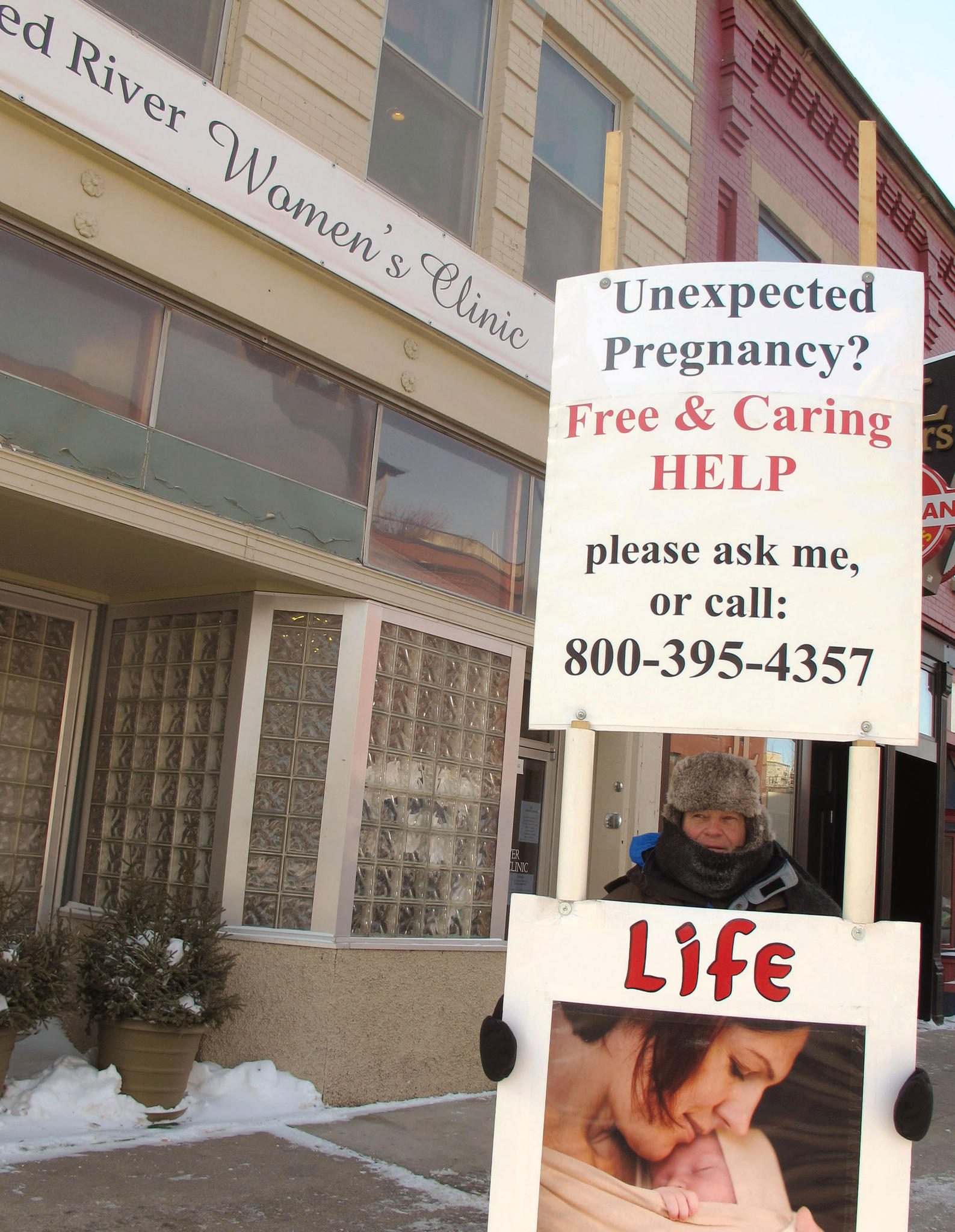 Protesters outside the Red River Valley Women's Clinic in Fargo, the only abortion provider in North Dakota. A federal judge ruled Wednesday that the state's ban on abortions after 6 weeks is unconstitutional.