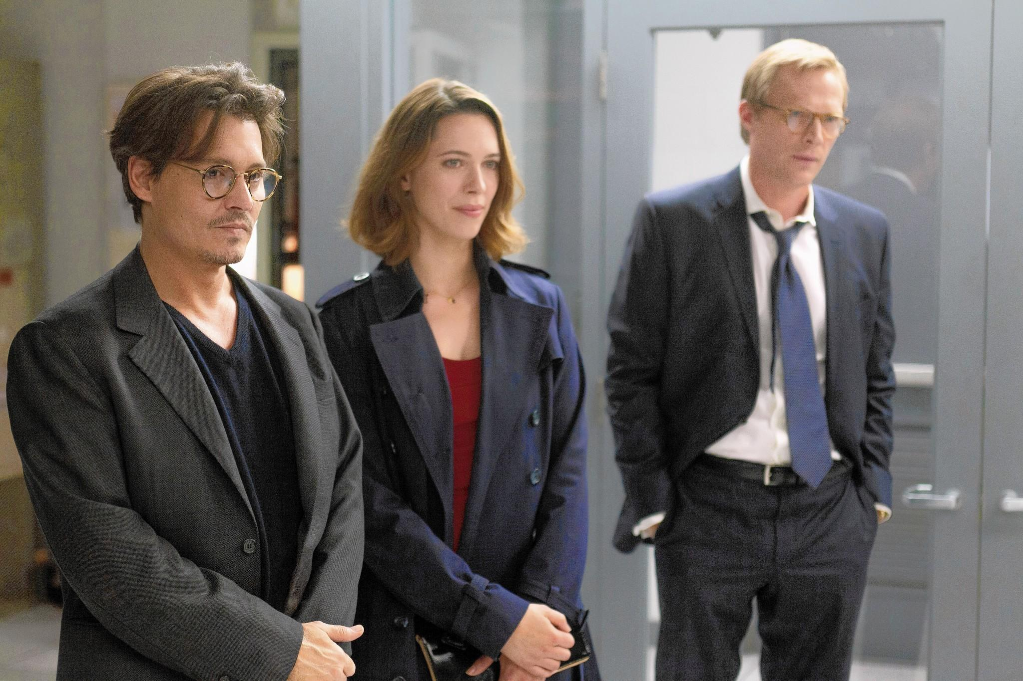 "Johnny Depp, Rebecca Hall and Paul Bettany in ""Transcendence."""