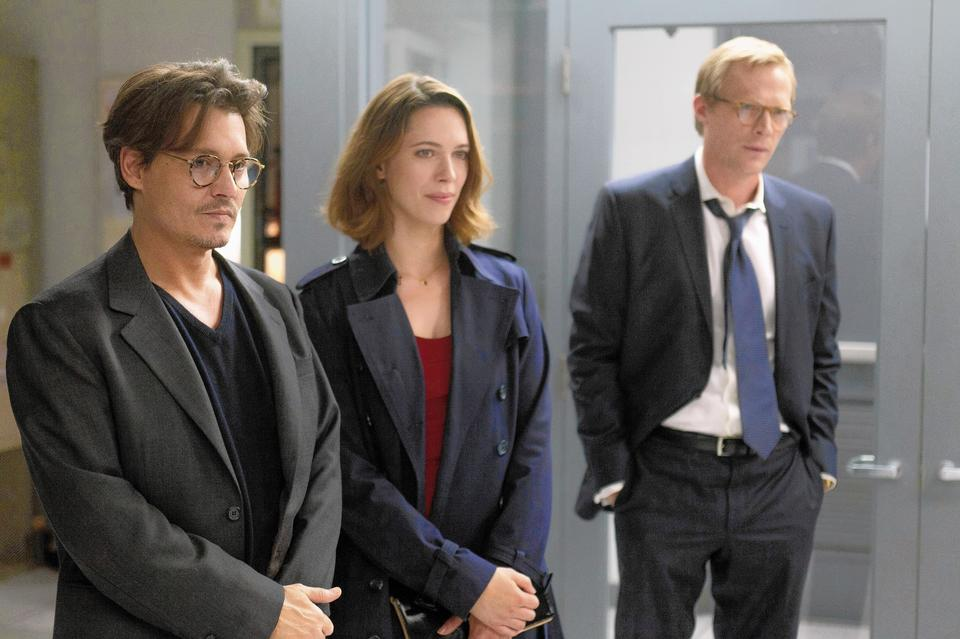"""Johnny Depp, Rebecca Hall and Paul Bettany in """"Transcendence."""""""