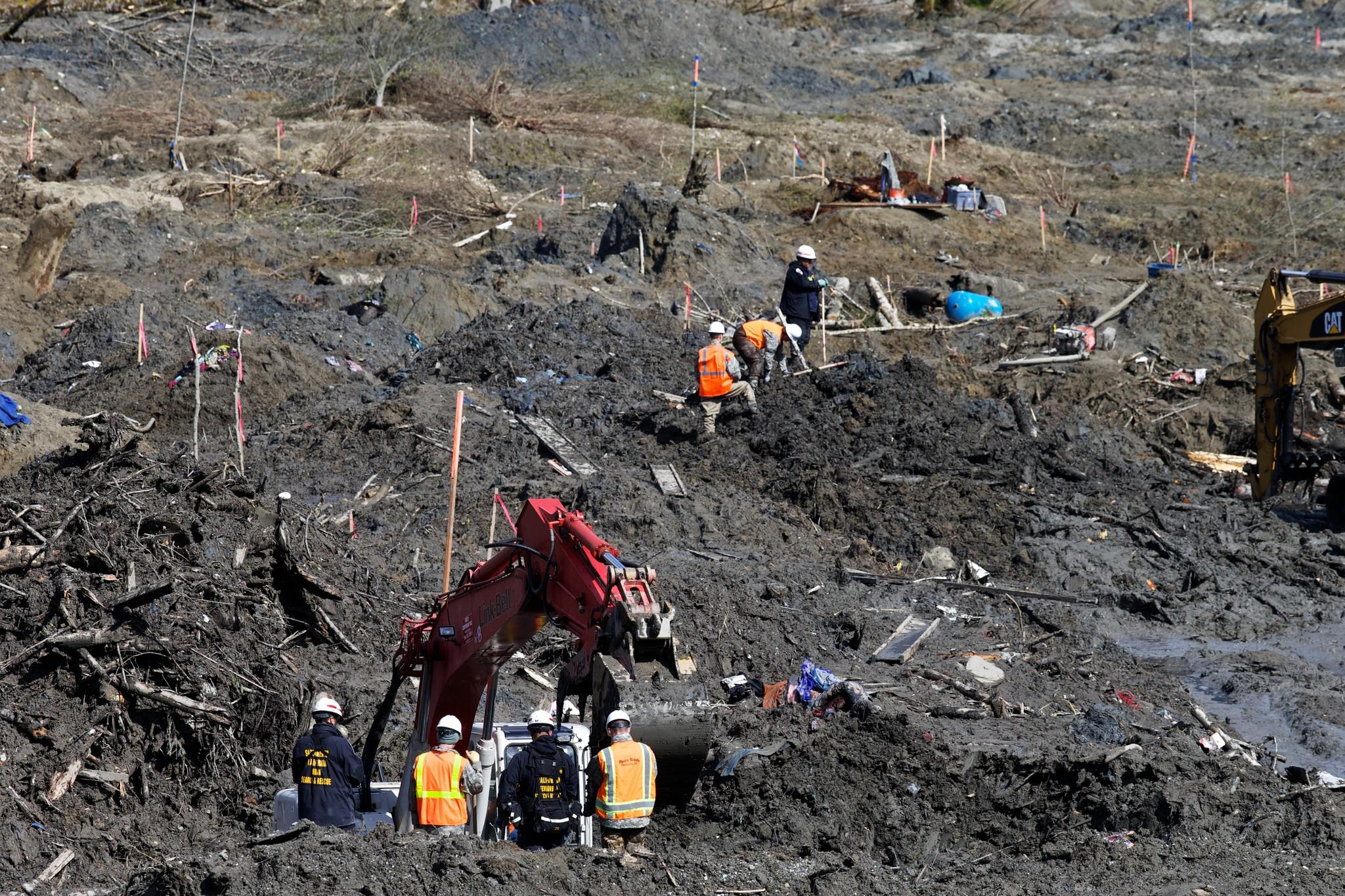 Search-and-rescue personnel continue the search for bodies buried in mud after the landslide in Oso, Wash. Thirty-nine bodies have been recovered from the scene.