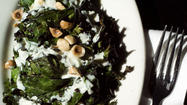 Recipe: Grilled Russian kale with yogurt dressing and toasted hazelnuts