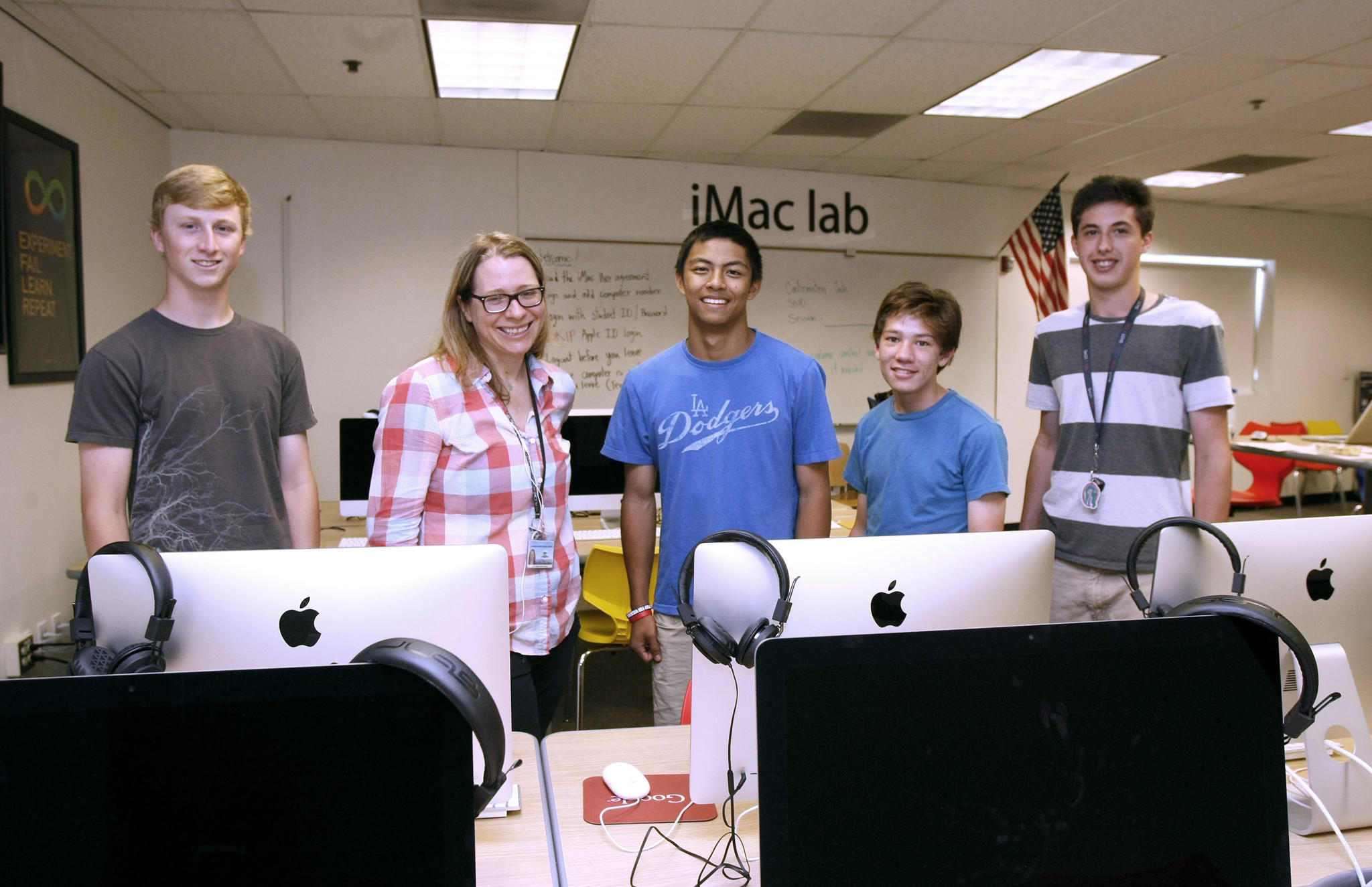Some members of the La Cañada High School iTeam club include, left to right, Clay Massimino, adviser Jamie Lewsadder, Matthew Pasion, Braden Oh and club president Jonathan Connelly, at the iMac lab on campus on Tuesday, April 14, 2014.