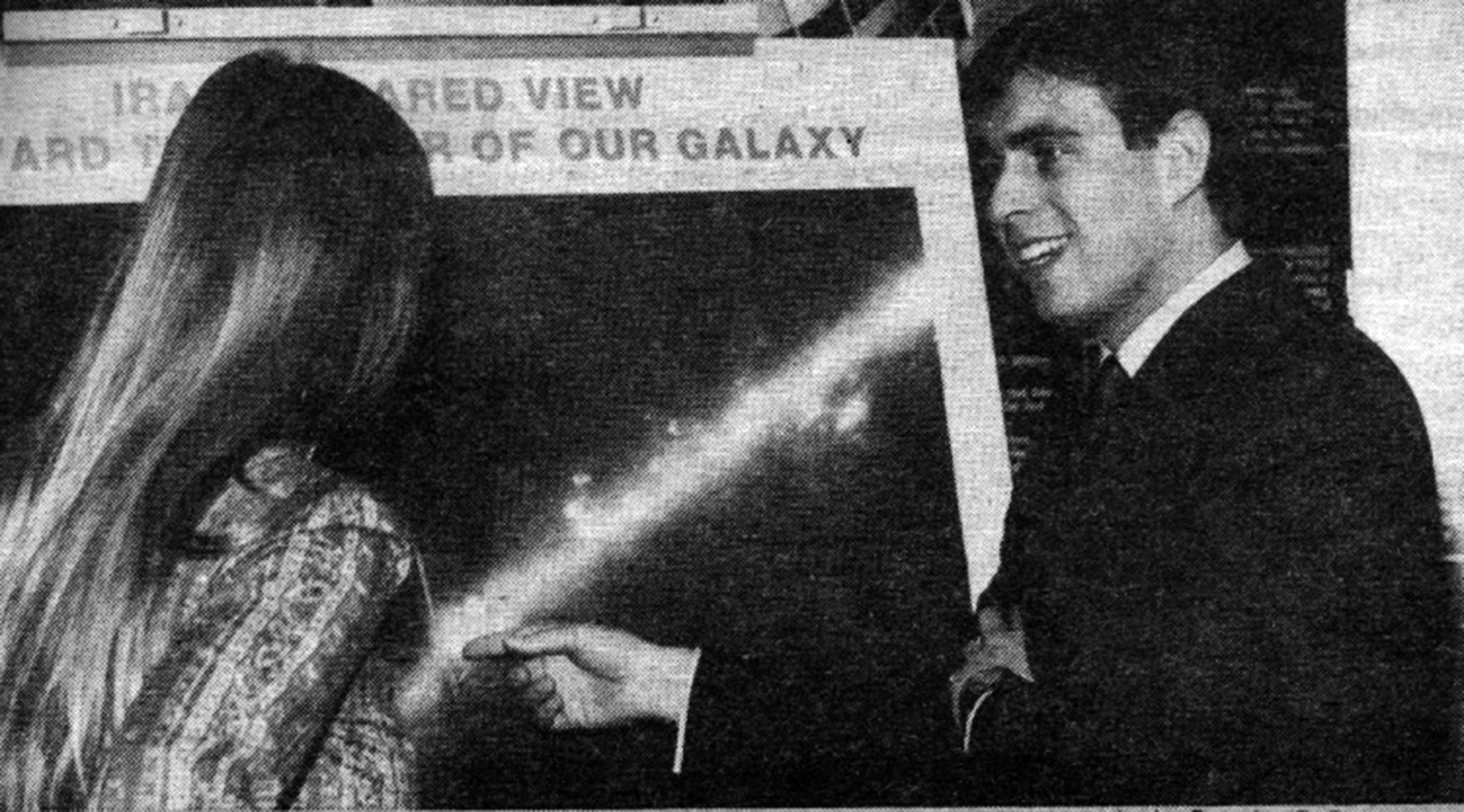 Great Britain's Prince Andrew points to a representation of our galaxy during a 90-minute tour of the Jet Propulsion Laboratory in April 1984. With him is Dr. Carol Persoon.