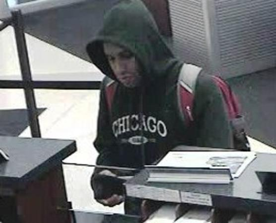 Surveillance photograph of a man who robbed a Loop bank on Tuesday. The FBI and Chicago Police later arrested a man who admitted to having robbed the bank. The FBI's Bandit Tracker website identified the man as the Benchwarmer bandit, who before Tuesday had robbed five banks since March 16.