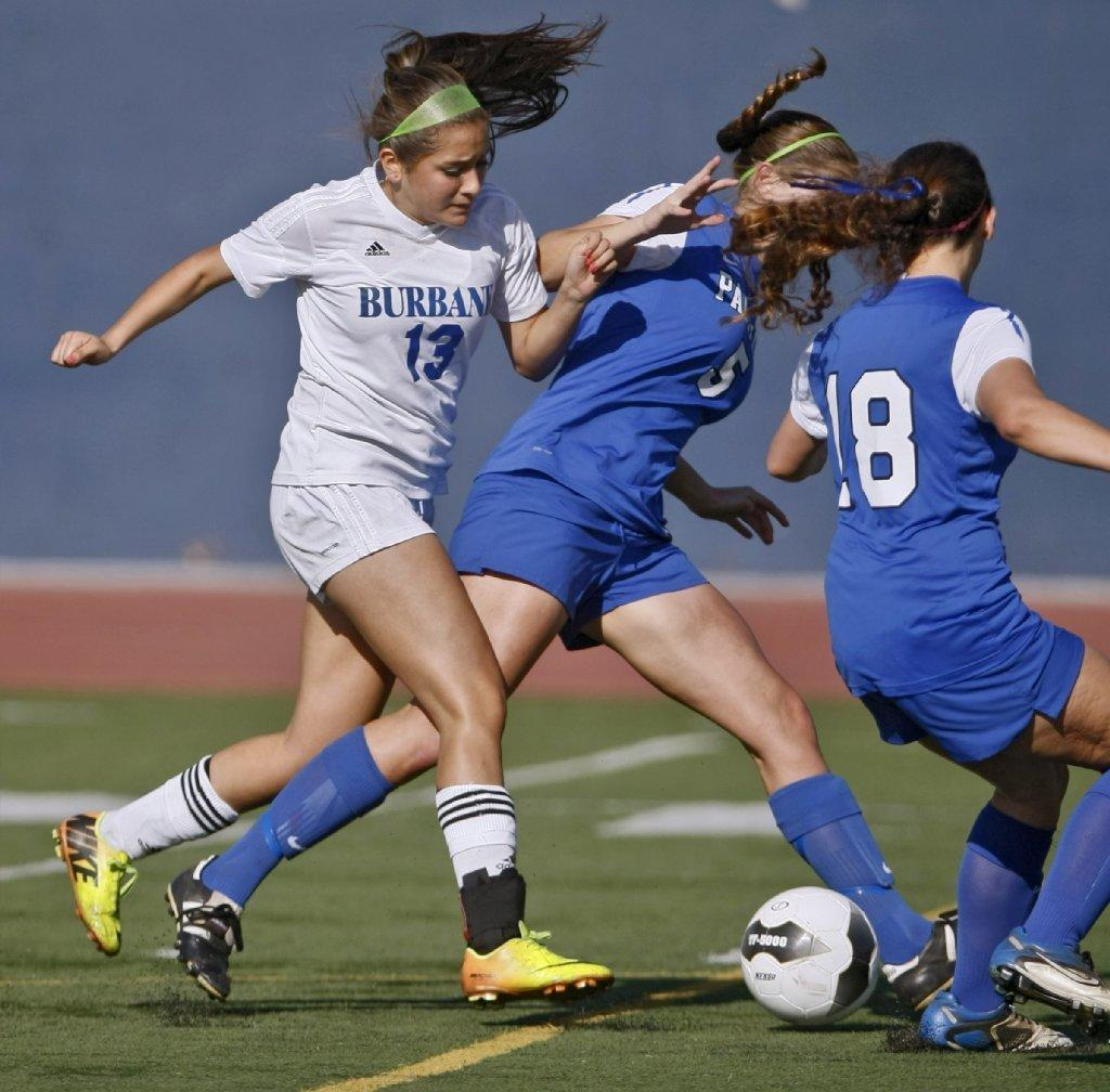 Burbank High's Clarissa Guerrero (left) was named to the 2014 All-Area Girls' Soccer First Team. (Raul Roa/Staff Photographer)