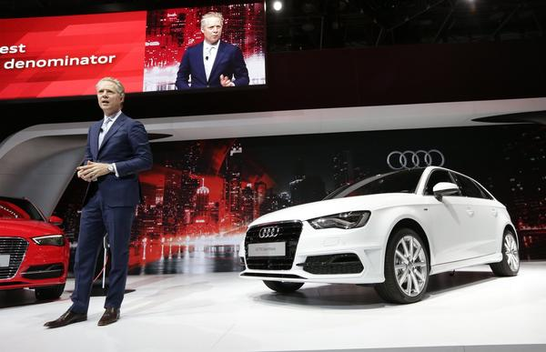 Scott Keogh, president of Audi America, addresses the media alongside the new A3 TDI Sportback at the New York International Auto Show.