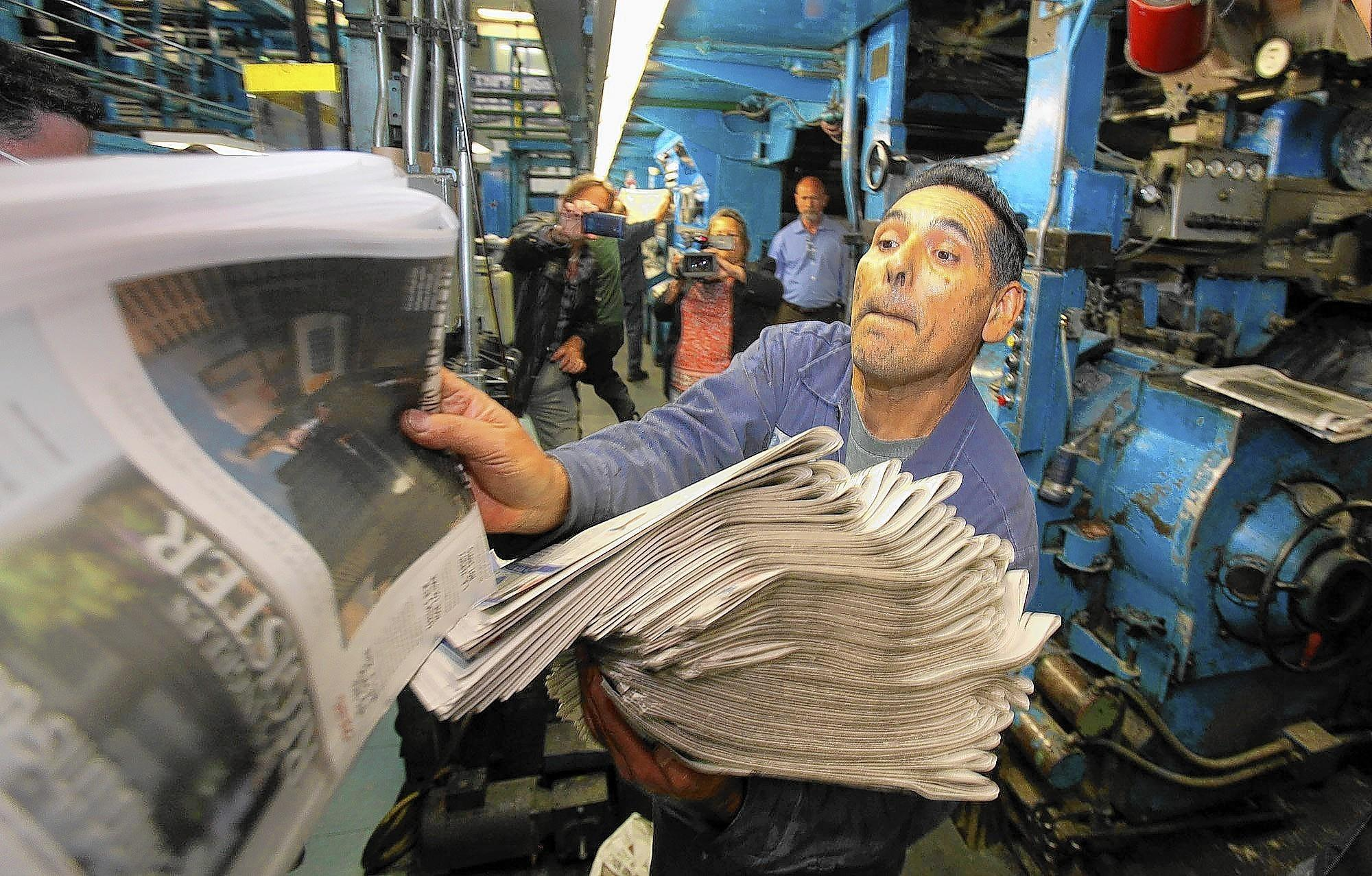 The L.A. Register, which will be sold at more than 5,500 retail outlets and vending machines, is the first new daily newspaper to launch in the city since the Los Angeles Daily News gradually turned into a daily in 1981. Above, workers check the first copies of the Register's inaugural edition at the newspaper's printing facility in Santa Ana.