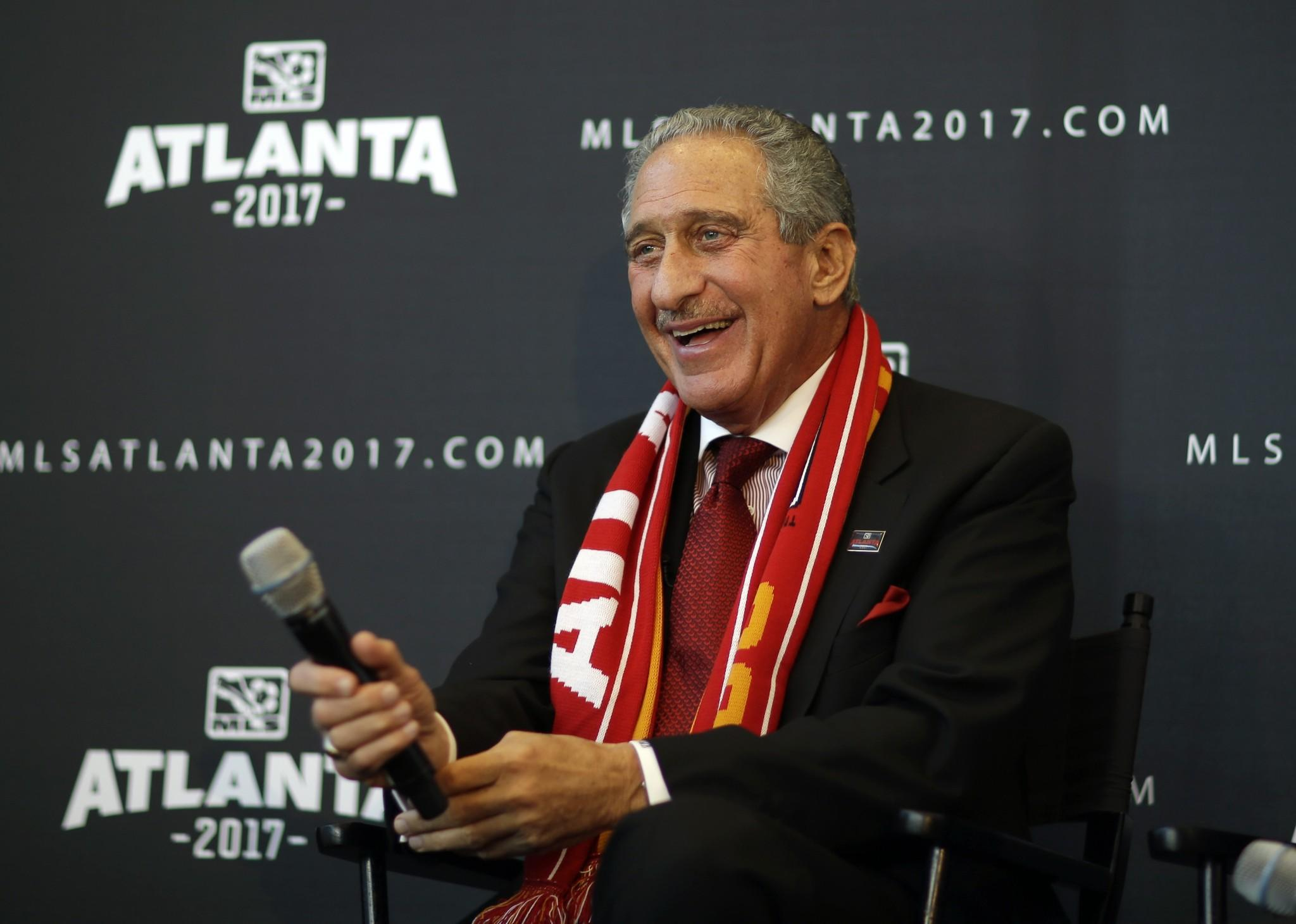 Arthur Blank, owner of the Atlanta Falcons, smiles during a news conference Wednesday to announce that Atlanta will receive a Major League Soccer franchise. Blank will be the new team's owner.