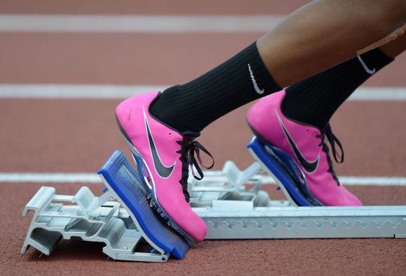 The famous swoosh on a high school runner's feet at a California meet last week.