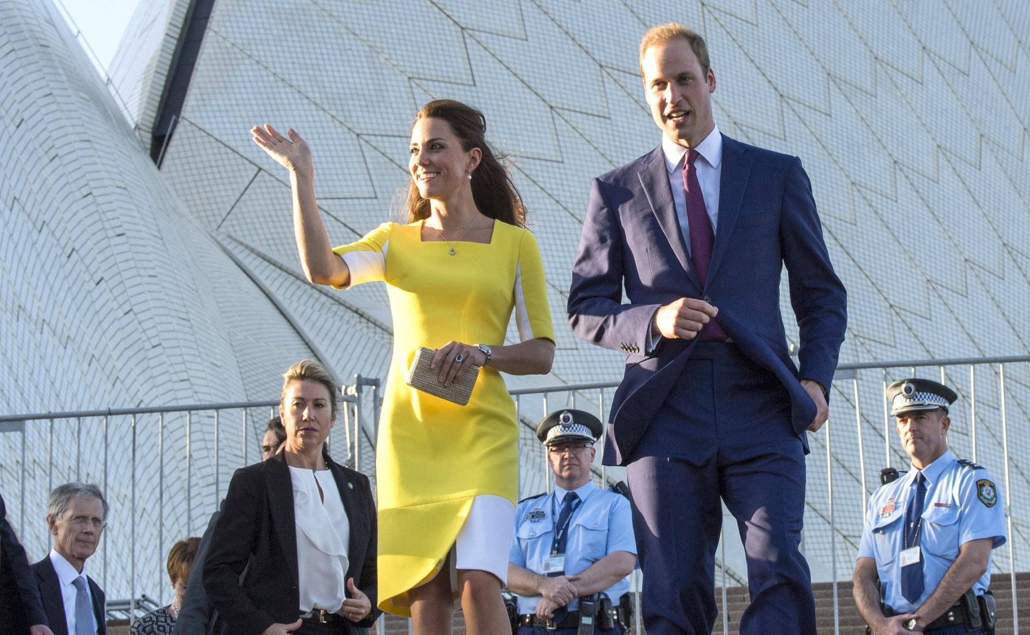 Prince William, Duke of Cambridge and Catherine, Duchess of Cambridge walk near the Sydney Opera House.