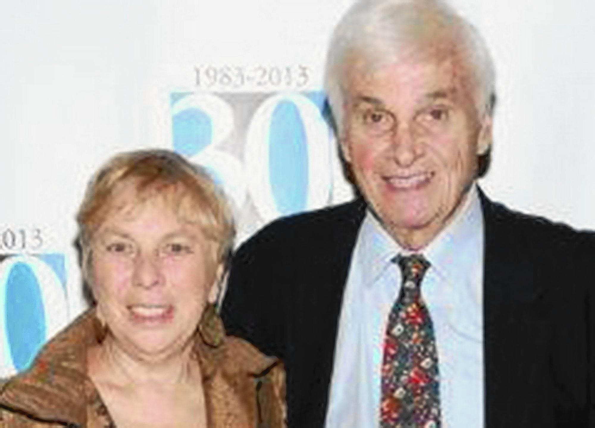 Gene Estess, a broker who gave up the pay and perks of Wall Street for a second career with the Jericho Project, a social-service organization helping New York City's homeless, has died at 78. Estess is pictured with his wife, Pat Schiff Estess.
