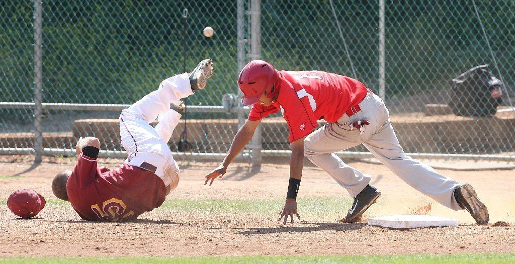Glendale Community College's Jack Sheeley takes a tumble as L.A. Pierce's Angel Cruz makes it safe back to first and then makes it to second during a game on Wednesday. (Roger Wilson/Staff Photographer)