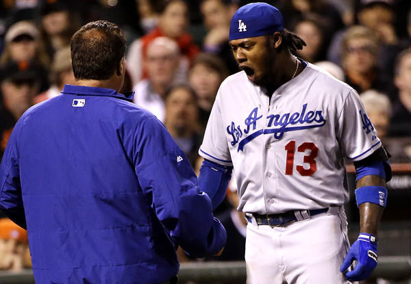 Dodgers shortstop Hanley Ramirez reacts after getting hit on the left hand by a pitch from Giants starter Ryan Vogelsong in the seventh inning Wednesday night in San Francisco.
