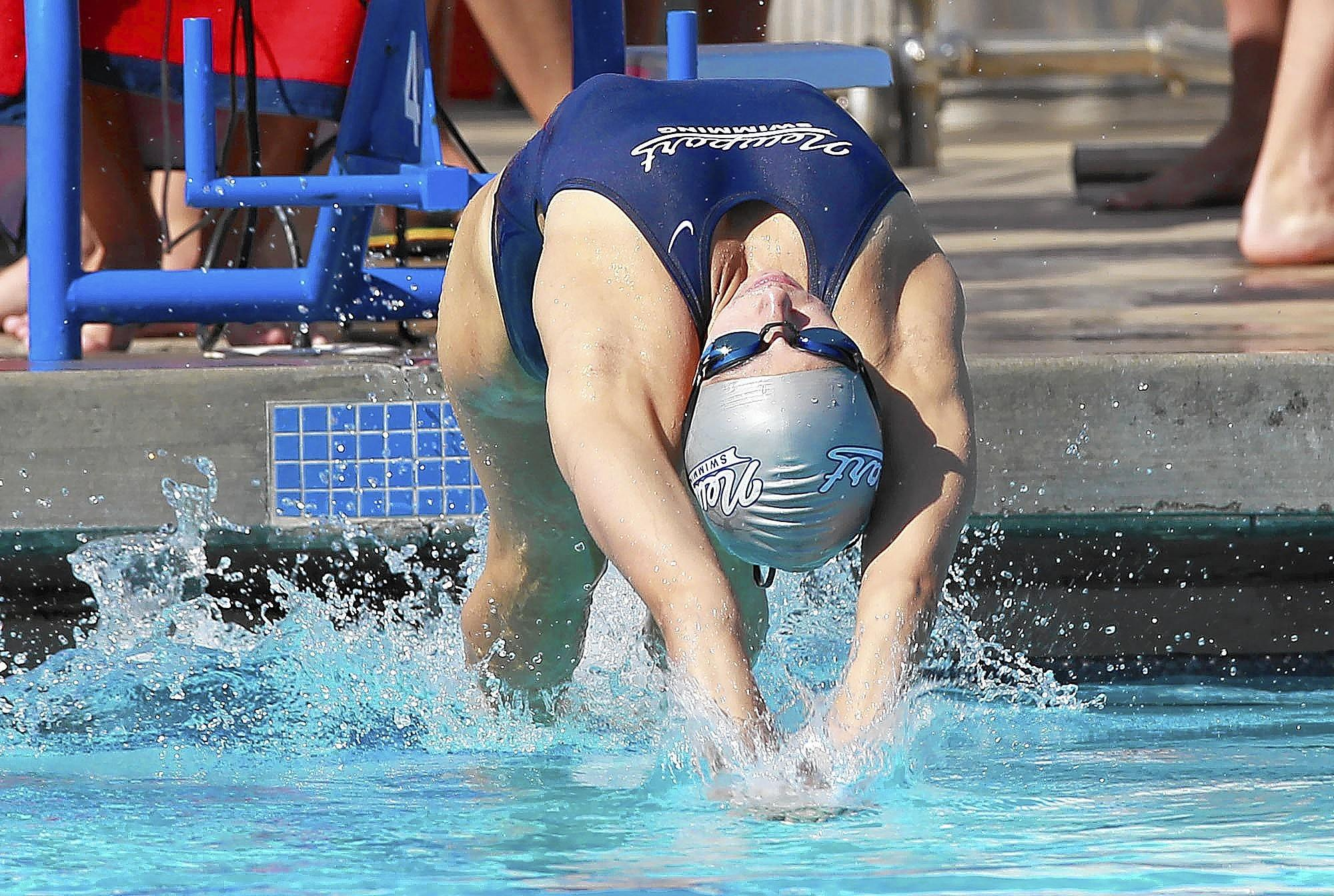 Newport Harbor High's Marissa Robertson explodes off the starting line for the backstroke leg in the medley relay during the Battle of the Bay swim meet at Corona del Mar on Wednesday.