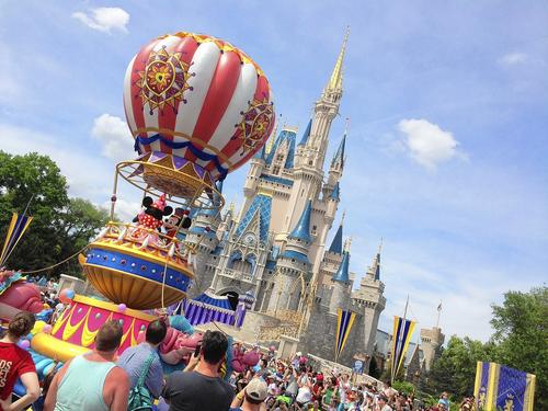 The final float of the Festival of Fantasy parade passes by the area reserved for FastPass+ users at Magic Kingdom.
