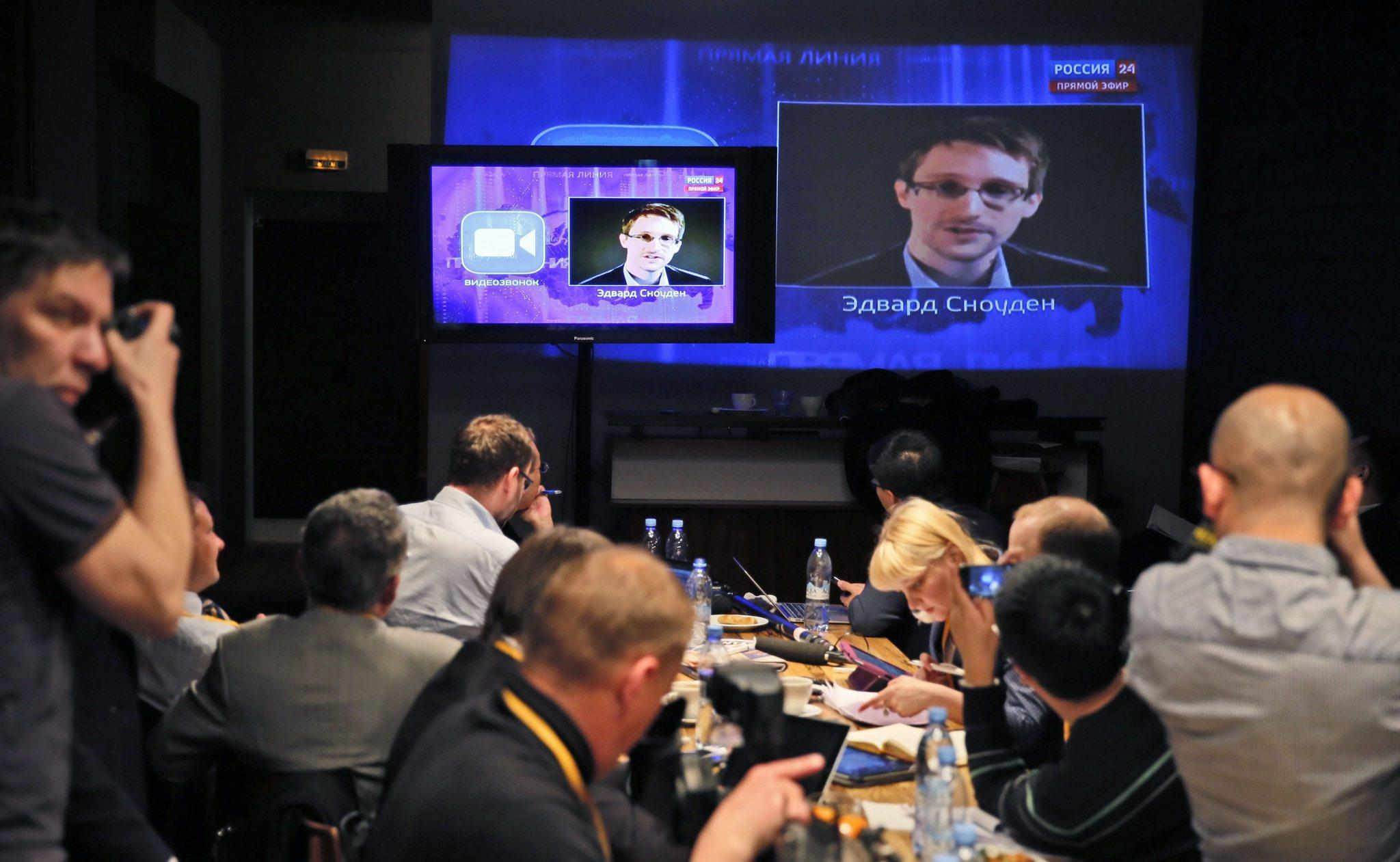 Journalists listen to a question posed by former U.S. spy agency NSA contractor Edward Snowden during Russian President Vladimir Putin's live broadcast on April 17. (EPA)