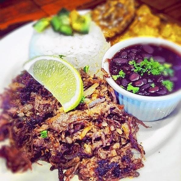 Shredded skirt steak pan-seared with lime and onion, served with white rice, black beans and tostones.