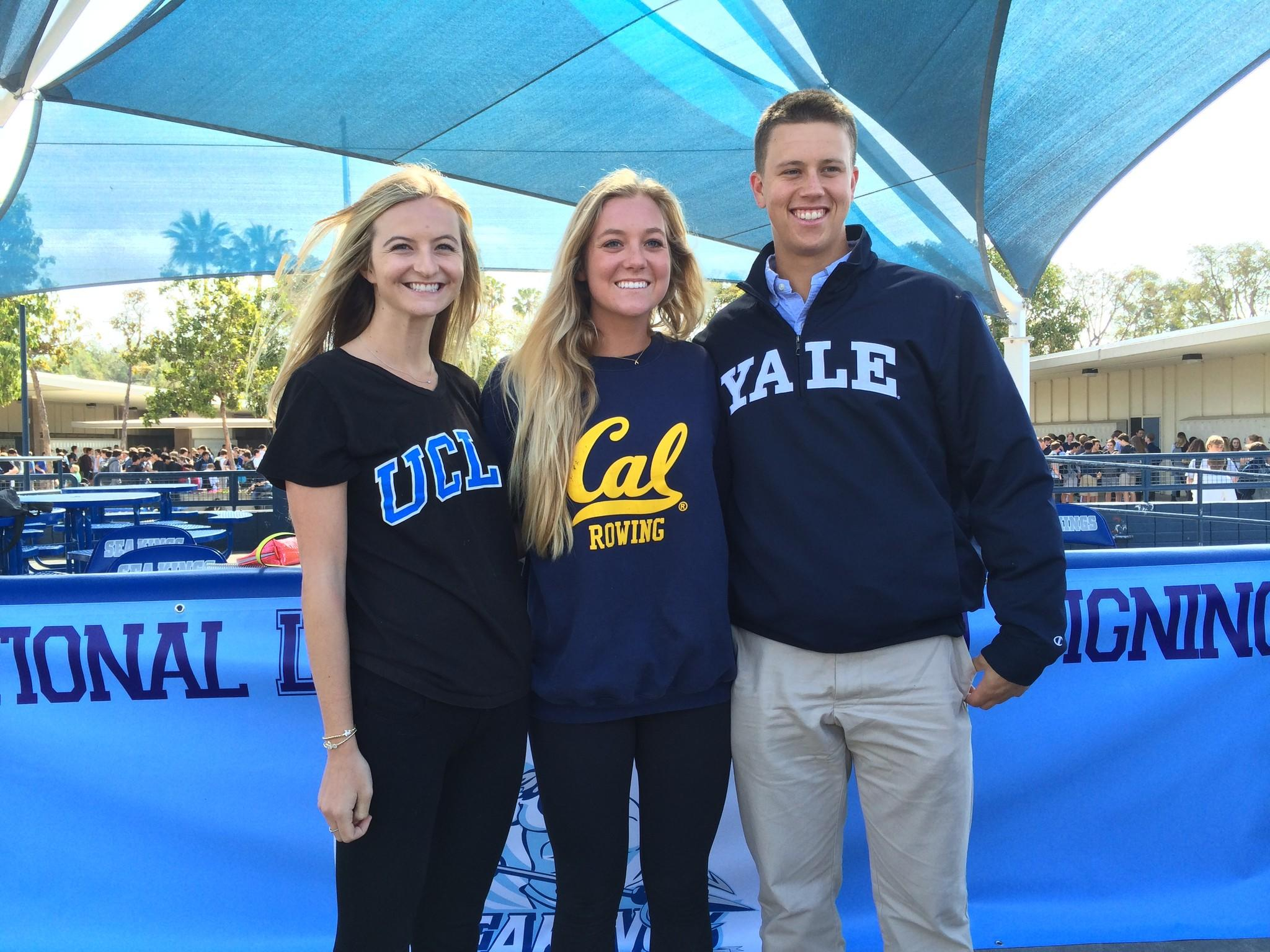 From left, Corona del Mar High's Kenzie Purcifull (UCLA women's tennis), Elizabeth Russell (UC Berkeleym women's rowing) and Tyler Duncan (Yale baseball) smile at the National Letter of Intent Signing Day at CdM.