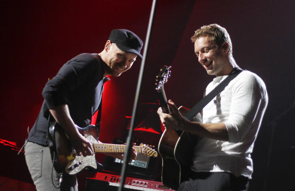 "Coldplay's Jonny Buckland, left, and Chris Martin, shown performing in March in Austin, and the rest of the group will play May 19 at UCLA's Royce Hall in conjunction with the worldwide release that day of the band's new album ""Ghost Stories."""