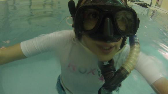 Selfie: RedEye reporter Leonor Vivanco photographs underwater hockey players using an underwater GoPro.