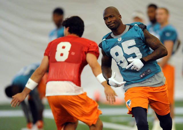 Miami Dolphins wide receiver Chad Johnson (right) and quarterback Matt Moore (left) during practice at the Dolphins training facility.