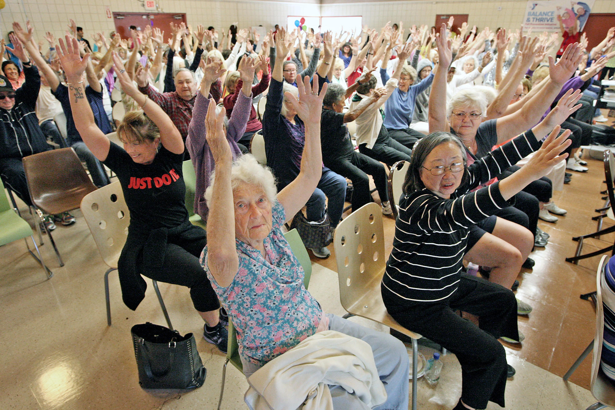 Seniors work on their balance skills during a kickoff of the Crescenta-Cañada YMCA's new Healthy Living program called Balance and Thrive for people 65 and older.