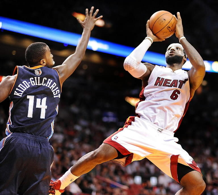 LeBron James shoots over the hand of Charlotte guard Michael Kidd-Gilchrist in the Heat's March win.