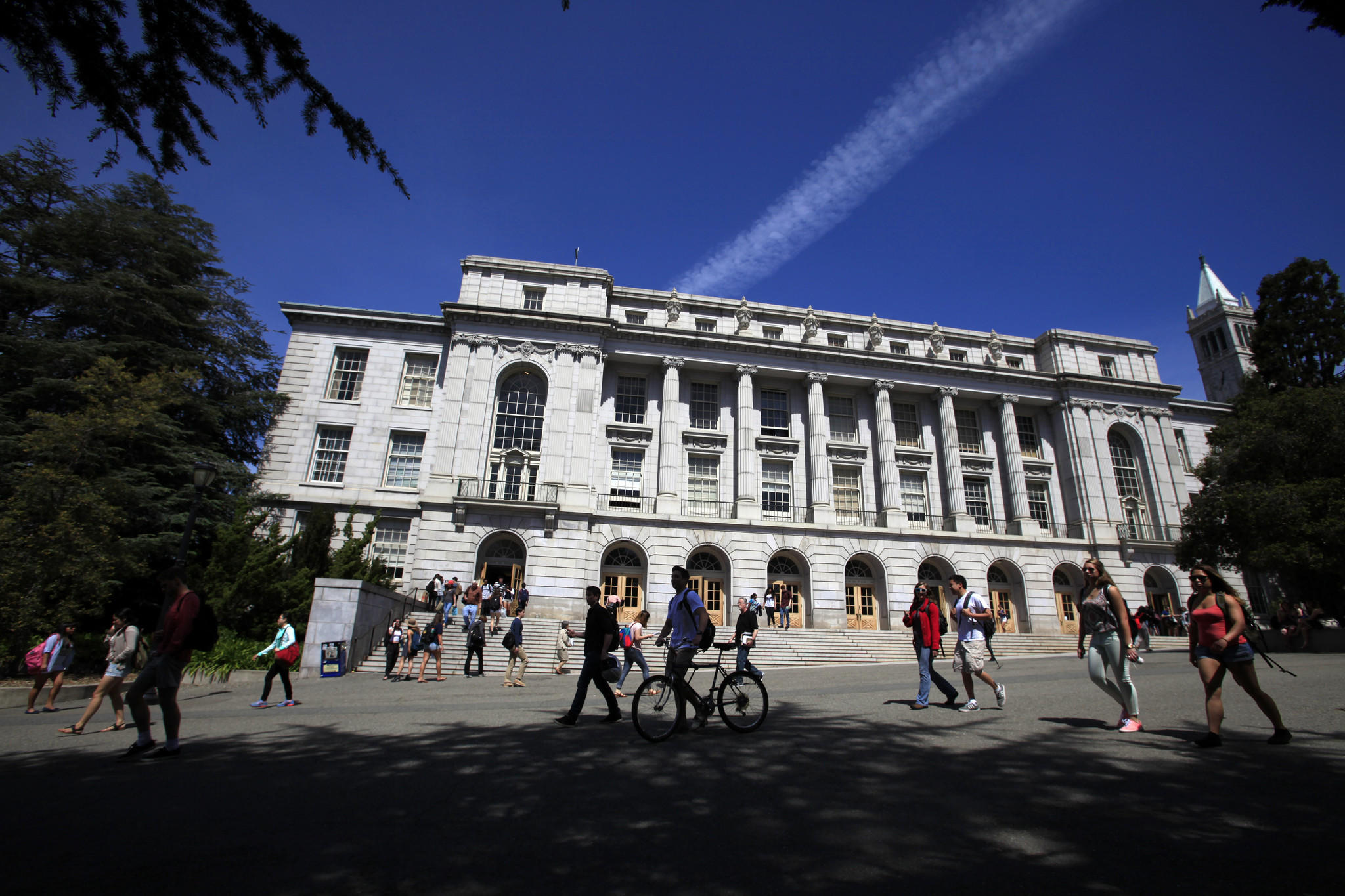 UC Berkeley students walk in front of Wheeler Hall. Only 18.8% of state residents who applied were offered a spot at Berkeley this year. Last year the rate was 21.4%.