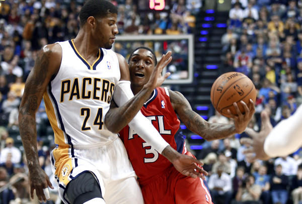 Paul George (24), fouling Hawks guard Louis Williams, and the struggling Pacers will open the Eastern Conference playoffs against eighth-seeded Atlanta.