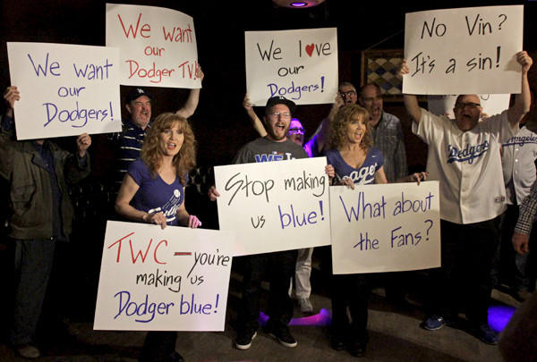 Fans voice their concern that SportsNet LA is only broadcasting Dodgers games on Time Warner Cable during a rally at the Short Stop bar in Echo Park on Wednesday night.