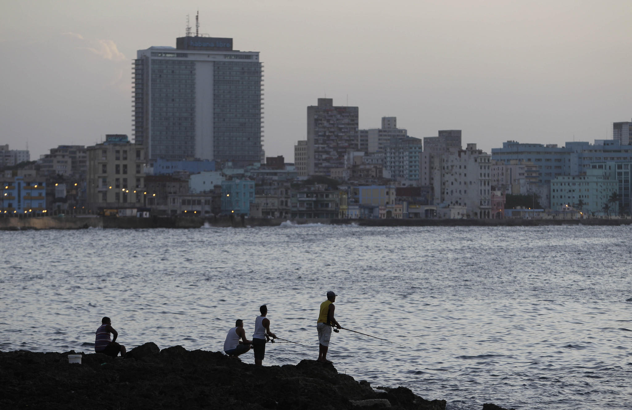 Fishermen cast their lines along the Malecon in Havana. The number of U.S. visitors to Cuba continues to rise.