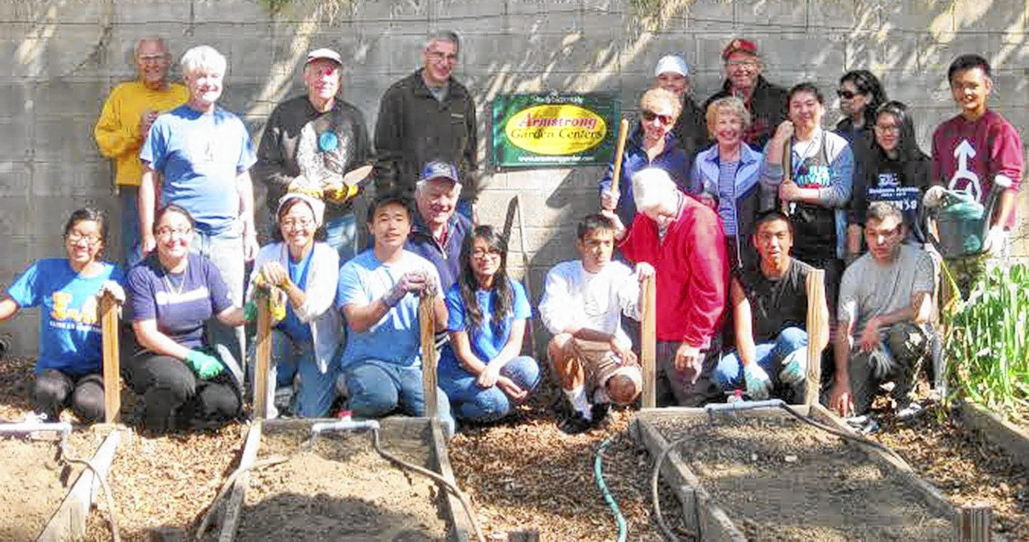 The La Cañada Kiwanis AM club participated in the Kiwanis One Day project with the Franklin High School K Club at the Lanterman House garden. Front row, from left, Krissy Wong, Arlene Anguiano, Elaine Harada, Franklin High School math teacher and K Club sponsor; Denis Tran, Mark Femandez, Jack Labrie, Elijah Trinidad and Brian Sanchez. Second row, from left, are Chuck McGee, Sean Crahan, David Hemstreet, Donn Sarbaum, Marie Hyland, Joan McGee, K Club President Jade Archuleta, Winny Chen and Jeffrey Fernandez. Back row, from left, Barbie Eland, Kiwanis AM president elect, President Joe Thompson and Mary Ann Ralser.