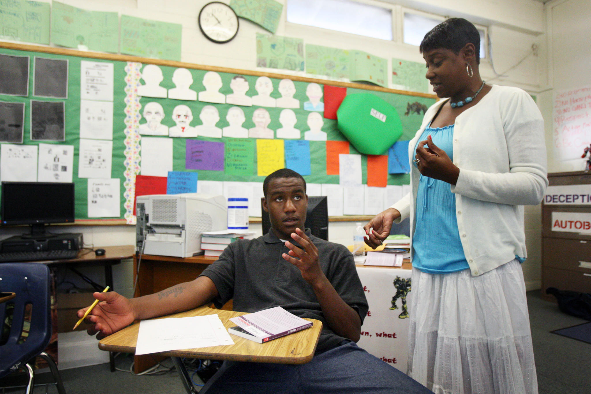 Marquis, 16, left, and English teacher Monica Jackson count the syllables in his haiku poem at Camp Afflerblaugh in La Verne. A new study found that California and other states were failing to adequately educate juvenile inmates but L.A. County court schools have made progress following a 2010 lawsuit.